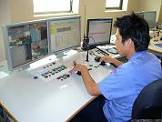 台北港貨櫃碼頭股份有限公司 - 遠端操控自動化門式機。